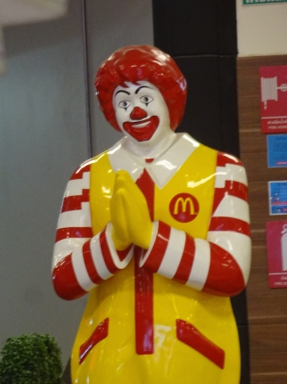 Ronald McDonald humbly welcoming the 50 billionth customer.